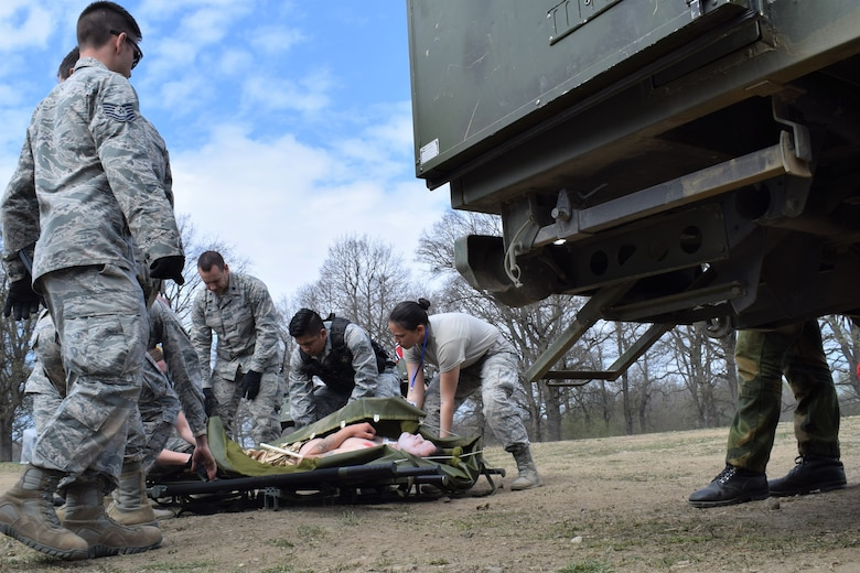 Airmen from the 86th Medical Group, Ramstein Air Base, Germany, participate in a multinational medical exercise drill during Vigorous Warrior 19, Cincu Military Base, Romania, April 8, 2019. During the exercise, medical personnel kept up a rigorous operations tempo that included more than 1,000 scenarios, 300 medical actions, and more than 1,500 simulated casualties. (U.S. Air Force photo by 1st Lt. Andrew Layton)