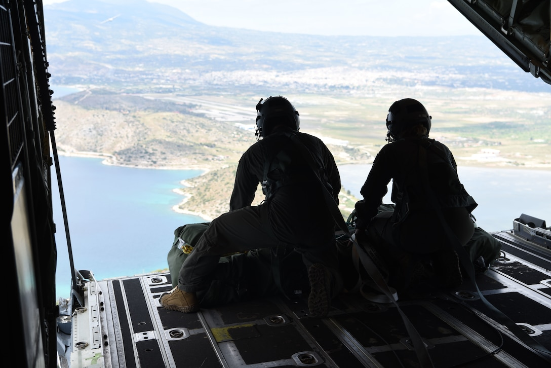 Two U.S. Air Force loadmasters from the 37th Airlift Squadron, Ramstein Air Base, Germany, prepare to drop cargo out of a C-130J Super Hercules during exercise Stolen Cerberus VI, May 8, 2019, off the coast of Greece. Stolen Cerberus is an annual bilateral training event with the Hellenic Air Force designed to enhance interoperability and airlift capabilities through realistic joint air operations training, including aeromedical evacuation operations and airlift and airdrop capabilities.