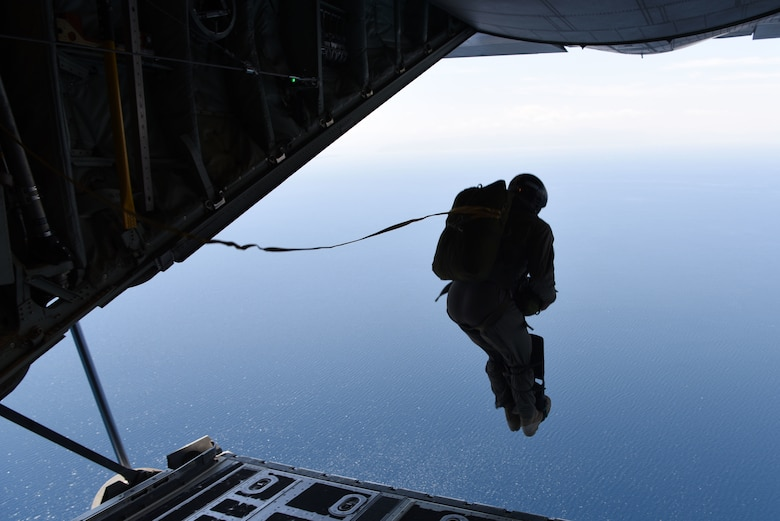 A Hellenic Navy seaman jumps out of a U.S. Air Force C-130J Super Hercules into the Aegean Sea, during exercise Stolen Cerberus VI, May 9, 2019, off the coast of Greece. Stolen Cerberus is an annual bilateral training event with the Hellenic air force designed to enhance interoperability and airlift capabilities through realistic joint air operations training, including aeromedical evacuation operations and airlift and airdrop capabilities.