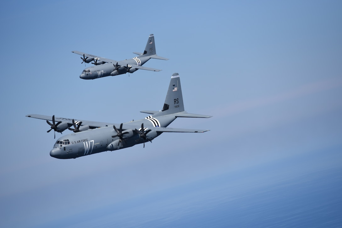Two U.S. Air Force C-130J Super Hercules fly above the Aegean Sea during exercise Stolen Cerberus VI, May 9, 2019, off the coast of Greece. Stolen Cerberus is an annual bilateral training event with the Hellenic air force designed to enhance interoperability and airlift capabilities through realistic joint air operations training, including aeromedical evacuation operations and airlift and airdrop capabilities.