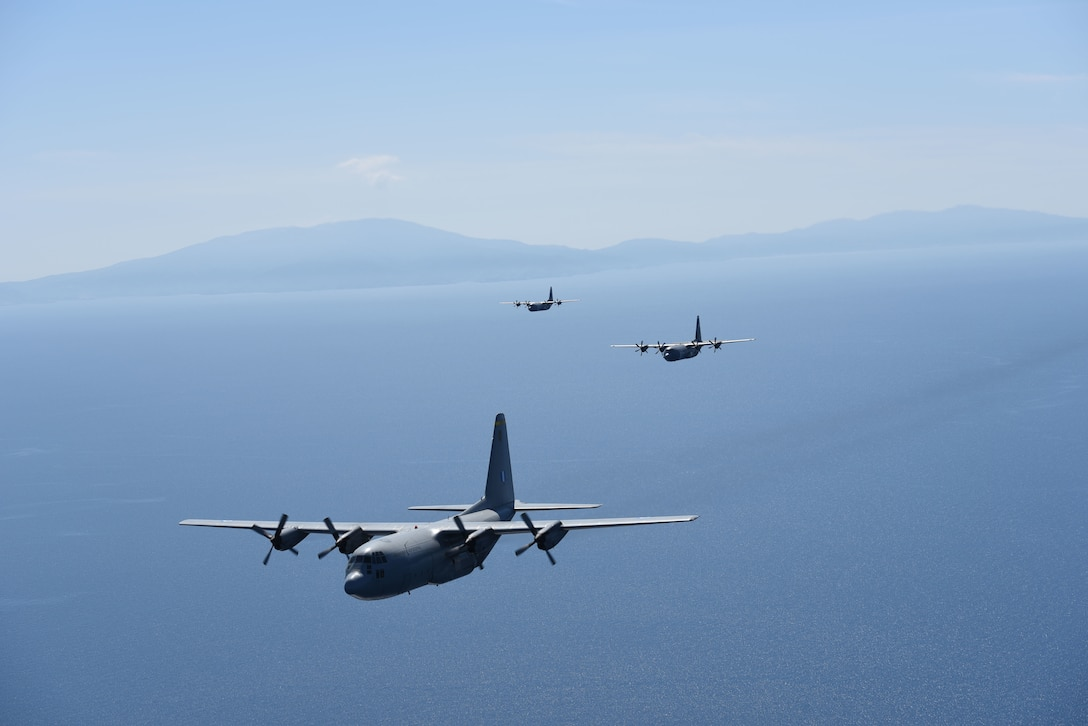 A Hellenic air force C-130 Hercules along with two U.S. Air Force C-130J Super Hercules fly above the Aegean Sea during exercise Stolen Cerberus VI, May 9, 2019, off the coast of Greece. Stolen Cerberus is an annual bilateral training event with the Hellenic air force designed to enhance interoperability and airlift capabilities through realistic joint air operations training, including aeromedical evacuation operations and airlift and airdrop capabilities.