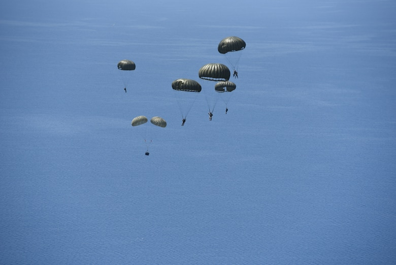 Hellenic military members parachute to a drop zone in the Aegean Sea during exercise Stolen Cerberus VI, May 9, 2019, off the coast of Greece. Stolen Cerberus is an annual bilateral training event with the Hellenic air force designed to enhance interoperability and airlift capabilities through realistic joint air operations training, including aeromedical evacuation operations and airlift and airdrop capabilities.