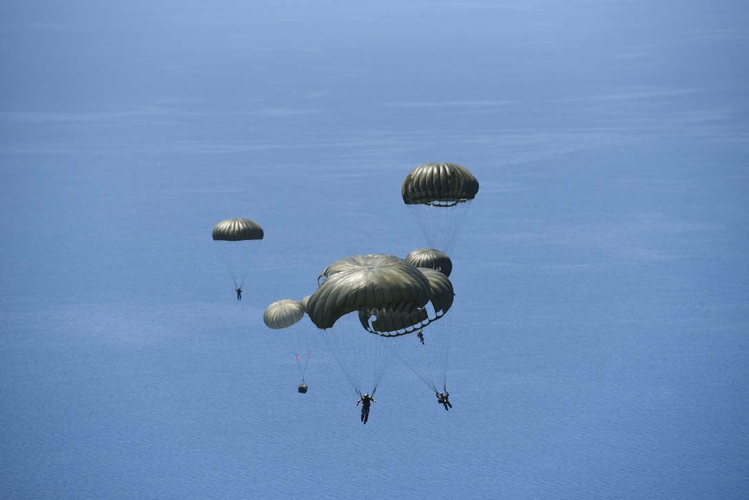 Hellenic military members prepare to land in the Aegean Sea, after jumping out of a U.S. Air Force C-130J Super Hercules, during exercise Stolen Cerberus VI, May 9, 2019, off the coast of Greece. Stolen Cerberus is an annual bilateral training event with the Hellenic air force designed to enhance interoperability and airlift capabilities through realistic joint air operations training, including aeromedical evacuation operations and airlift and airdrop capabilities.