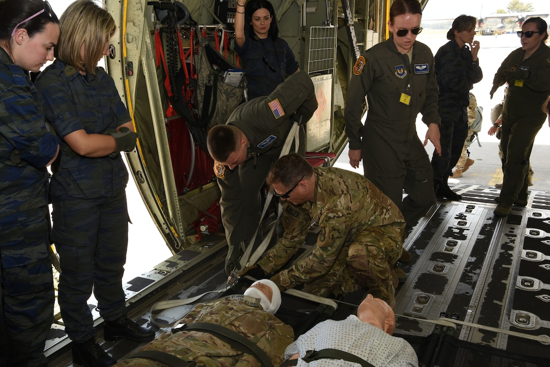 Airmen from the 86th Aeromedical Evacuation Squadron, Ramstein Air Base, Germany, conduct combat medical training with medical personnel from the Hellenic military, during exercise Stolen Cerberus VI, May 10, 2019, on Elefsis Air Base, Greece. Stolen Cerberus is an annual bilateral training event with the Hellenic air force designed to enhance interoperability and airlift capabilities through realistic joint air operations training, including aeromedical evacuation operations and airlift and airdrop capabilities.