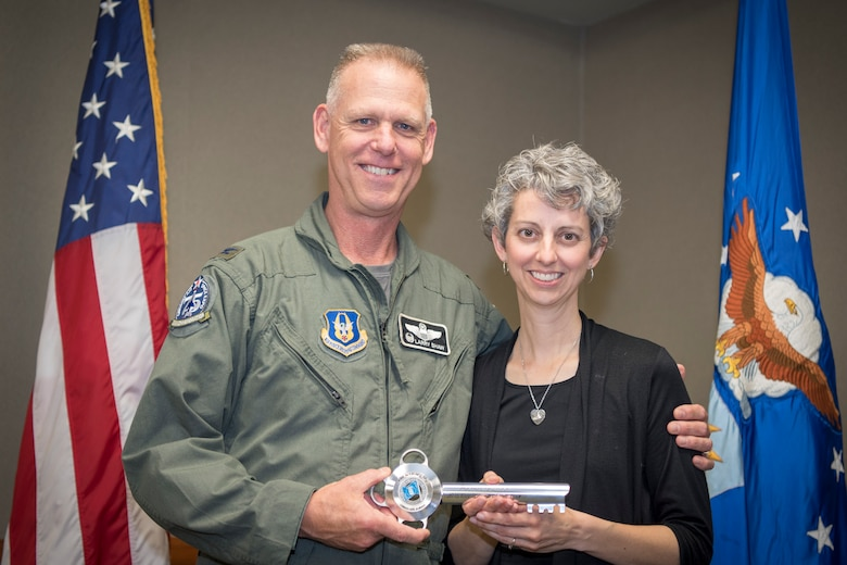 Rachel Grasmick, 434th Air Refueling Wing Key Spouse volunteer and Col. Larry Shaw, 434th ARW commander, pose for a photo after she received a key spouse award during a volunteer appreciation event at Grissom Air Reserve Base, Indiana, May 4, 2019. Grasmick received the 2018 Key Spouse award for her service to the program donating more than 250 hours supporting Airmen and family of Grissom service members. (U.S. Air Force photo/Master Sgt. Ben Mota)