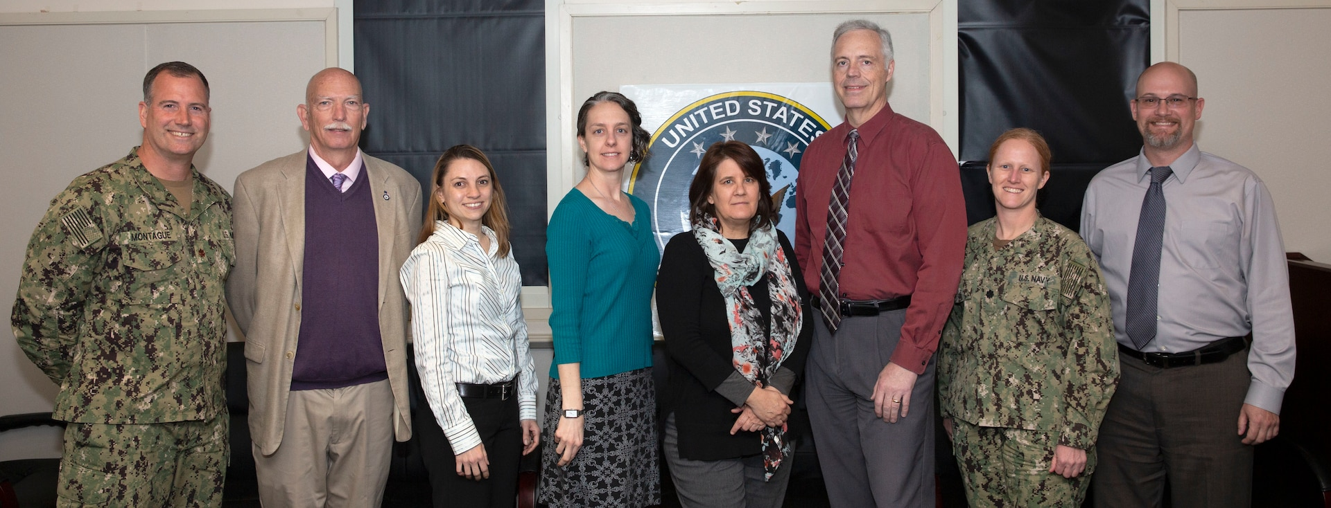USFFC Staff pose for a group photo after receiving a 2019 Secretary of the Navy Environmental Award for environmental planning of the AFTT Study Area Phase III Environmental Impact Statement.