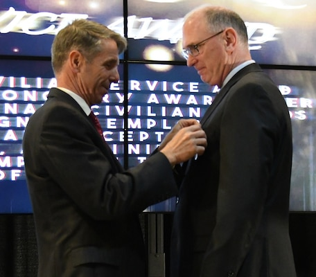 IMAGE: Fredericksburg, Va. (May 10, 2019) – U.S. Rep. Rob Wittman pins the Department of the Navy Superior Civilian Service Medal on Gilbert Goddin at the Naval Surface Warfare Center Dahlgren Division (NSWCDD) annual honor awards ceremony. Goddin was recognized for his remarkable management abilities, innovative thinking, and outstanding leadership serving as the chief systems engineer for the Electromagnetic Railgun and the Hypervelocity Gun Weapon System development and integration efforts from May 2015 to November 2017.  (U.S. Navy photo/Released)