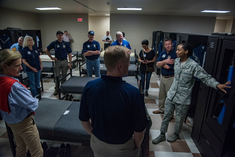 "Air Mobility Command civic leaders observe the dormitories of basic training, Joint Base San Antonio-Lackland, Texas, May 2, 2019.  The civic leaders toured the 37th Training Wing, also known as the ""Gateway Wing,"" as guests of AMC Cmmander Gen. Maryanne Miller. (U.S. Air Force photo by Traci Howells)"