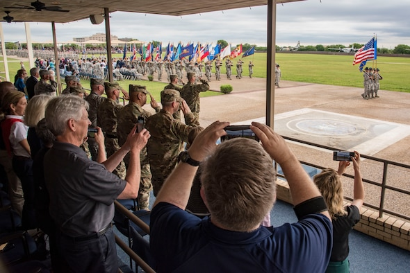 """Air Mobility Command civic leaders observe the graduation ceremony of the United States Air Force's newest Airmen, Joint Base San Antonio-Lackland, Texas, May 2, 2019.  The civic leaders toured the 37th Training Wing, also known as the """"Gateway Wing,"""" as guests of AMC Cmmander Gen. Maryanne Miller."""