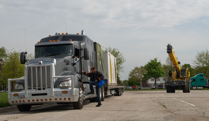 George Peny, an electronics technician assigned to the 4th Component Maintenance Squadron at Seymour Johnson Air Force Base (AFB), North Carolina, meets a semi-truck as it delivers a piece of a Rapid Assistance Support for Calibration unit (RASCAL) May 6, 2019, at Offutt Air Force Base, Nebraska. The RASCAL was deployed from Seymour Johnson AFB to assist Offutt AFB's Precision Measurement Equipment Laboratory staff who lost their facility in the March 2019 flood. (U.S. Air Force photo by L. Cunningham)