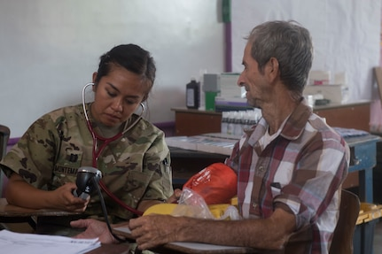 U.S. Army Capt. Allyssa Montemayor, Joint Task Force – Bravo Medical Element registered nurse, takes a blood pressure measurement as part of a medical screening during a Medical Readiness Training Exercise (MEDRETE), May 9, 2019, in El Paraiso, Honduras. Members of JTF-B partnered with the Honduran Military and Ministry of Health to provide health care services for more than 1,300 Honduran citizens; reaching a third of the citizens in the towns of Argelia, Santa Maria and Las Dificultades in the El Paraiso Department. The goal of the mission was to provide the medical staff training in their areas of expertise as well as strengthen partnerships with Honduran allies. (U.S. Air Force photo by Staff Sgt. Eric Summers Jr.)