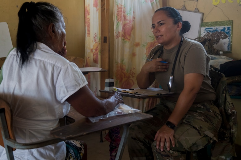 U.S. Army Capt. Sayda Fairfield, Joint Task Force – Bravo Medical Element physician assistant, address the concerns of a patient screening during a Medical Readiness Training Exercise (MEDRETE), May 9, 2019, in El Paraiso, Honduras. Members of JTF-B partnered with the Honduran Military and Ministry of Health to provide health care services for more than 1,300 Honduran citizens; reaching a third of the citizens in the towns of Argelia, Santa Maria and Las Dificultades in the El Paraiso Department. The goal of the mission was to provide the medical staff training in their areas of expertise as well as strengthen partnerships with the Honduran allies. (U.S. Air Force photo by Staff Sgt. Eric Summers Jr.)