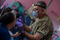 U.S. Army Col. Manuel Iravedra, Joint Task Force – Bravo Medical Element dentist, applies a numbing medication before a tooth extraction during a Medical Readiness Training Exercise (MEDRETE), May 9, 2019, in El Paraiso, Honduras. Members of JTF-B partnered with the Honduran Military and Ministry of Health to provide health care services for more than 1,300 Honduran citizens; reaching a third of the citizens in the towns of Argelia, Santa Maria and Las Dificultades in the El Paraiso Department. The goal of the mission was to provide the medical staff training in their areas of expertise as well as strengthen partnerships with the Honduran allies. (U.S. Air Force photo by Staff Sgt. Eric Summers Jr.)