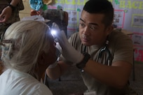 U.S. Army Spc. Alec Pagtakhan, Joint Task Force – Bravo Medical Element EMT medic, looks for signs of eye ailments as part of a medical screening during a Medical Readiness Training Exercise (MEDRETE), May 10, 2019, in El Paraiso, Honduras. Members of JTF-B partnered with the Honduran Military and Ministry of Health to provide health care services for more than 1,300 Honduran citizens; reaching a third of the citizens in the towns of Argelia, Santa Maria and Las Dificultades in the El Paraiso Department. The goal of the mission was to provide the medical staff training in their areas of expertise as well as strengthen partnerships with the Honduran allies. (U.S. Air Force photo by Staff Sgt. Eric Summers Jr.)