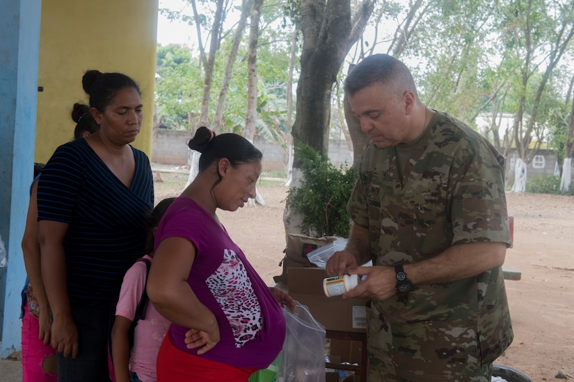U.S. Army Maj. Jorge Chavez, Joint Task Force Bravo Medical Element public health nurse, provides instructions for pre-natal vitamins after a preventive medicine brief during a Medical Readiness Training Exercise (MEDRETE), May 10, 2019, in El Paraiso, Honduras. Members of JTF-B partnered with the Honduran Military and Ministry of Health to provide health care services for more than 1,300 Honduran citizens; reaching a third of the citizens in the towns of Argelia, Santa Maria and Las Dificultades in the El Paraiso Department. The goal of the mission was to provide the medical staff training in their areas of expertise as well as strengthen partnerships with the Honduran allies. (U.S. Air Force photo by Staff Sgt. Eric Summers Jr.)