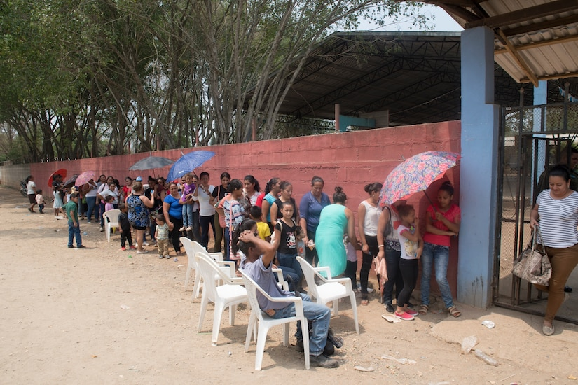 Honduran citizens stand in line to receive medical care during a Medical Readiness Training Exercise (MEDRETE), May 10, 2019, in El Paraiso, Honduras. Members of JTF-B partnered with the Honduran Military and Ministry of Health to provide health care services for more than 1,300 Honduran citizens; reaching a third of the citizens in the towns of Argelia, Santa Maria and Las Dificultades in the El Paraiso Department. The goal of the mission was to provide the medical staff training in their areas of expertise as well as strengthen partnerships with the Honduran allies. (U.S. Air Force photo by Staff Sgt. Eric Summers Jr.)