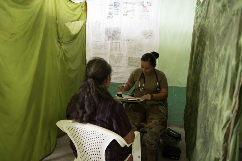 U.S. Army Capt. Sayda Fairfield, Joint Task Force – Bravo Medical Element physician assistant, address the concerns of a patient during a Medical Civil Action Program (MEDCAP), May 11, 2019, in El Paraiso, Honduras. Members of JTF-B partnered with the Honduran Military and Ministry of Health to provide health care services for more than 1,300 Honduran citizens; reaching a third of the citizens in the towns of Argelia, Santa Maria and Las Dificultades in the El Paraiso Department. The goal of the mission was to provide the medical staff training in their areas of expertise as well as strengthen partnerships with the Honduran allies. (U.S. Air Force photo by Staff Sgt. Eric Summers Jr.)