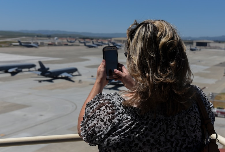 Leslie Jensen, Leadership Today course tour participant, photographs the flight line May 2, 2019 at Travis Air Force Base, California. The program is designed to develop knowledgeable, skilled, committed and active future leaders in the community. (U.S. Air Force photo by Airman 1st Class Cameron Otte)