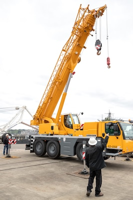 Functions of Puget Sound Naval Shipyard & Intermediate Maintenance Facility's newest mobile crane are demonstrated moments after a ribbon-cutting ceremony May 2