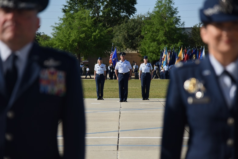 Keesler leadership stand at attention during the 81st Training Wing change of command ceremony on the Levitow Training Support Facility drill pad at Keesler Air Force Base, Mississippi, May 16, 2019. The ceremony is a symbol of command being exchanged from one commander to the next by the handing-off of a ceremonial guidon. U.S. Air Force Col. Debra Lovette, relinquished command of the 81st TRW to Col. Heather Blackwell. (U.S. Air Force photo by Kemberly Groue)