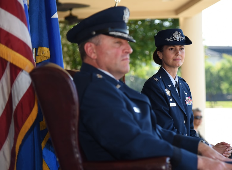 U.S. Air Force Maj. Gen. Timothy Leahy, Second Air Force commander, and Col. Heather Blackwell, incoming 81st Training Wing commander, look on as Col. Debra Lovette, outgoing 81st TRW commander, delivers her speech during the 81st TRW change of command ceremony on the Levitow Training Support Facility drill pad at Keesler Air Force Base, Mississippi, May 16, 2019. Blackwell assumed command from Col. Debra Lovette. (U.S. Air Force photo by Kemberly Groue)