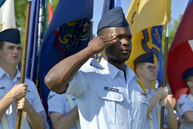 U.S. Air Force Airman 1st Class Tony Planter-Burgess, 336th Training Squadron student, salutes during the 81st Training Wing change of command ceremony on the Levitow Training Support Facility drill pad at Keesler Air Force Base, Mississippi, May 16, 2019. Col. Heather Blackwell assumed command from Col. Debra Lovette. (U.S. Air Force photo by Airman Seth Haddix)