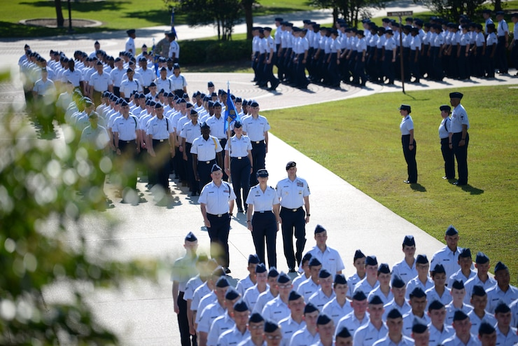 Airmen from the 81st Training Group march during the 81st Training Wing change of command ceremony on the Levitow Training Support Facility drill pad at Keesler Air Force Base, Mississippi, May 16, 2019. Col. Heather Blackwell assumed command from Col. Debra Lovette.  (U.S. Air Force photo by Airman 1st Class Spencer Tobler)