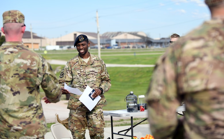 Senior Airman Charles Williams, a 28th Security Forces Squadron response force team member, announces the winners of the Police Week Ruck Challenge at Heritage Lake on Ellsworth Air Force Base, S.D., May 13, 2019.  Participants were required to complete the 4.5 mile ruck, while carrying at least 40 pounds on their backs. The challenge was held in recognition of National Police Week, which pays tribute to law enforcement officers who have died while serving communities nationwide. (U.S. Air Force photo by Airman 1st Class Christina Bennett)