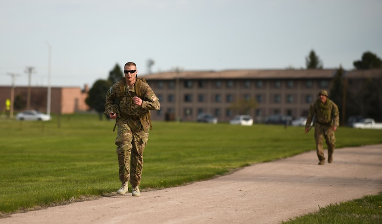 Chief Master Sgt. Jesse Franks, a 28th Security Forces superintendent, competes in the 4.5-mile Police Week Ruck Challenge at Heritage Lake on Ellsworth Air Force Base, S.D., May 13, 2019. National Police Week is recognized across the nation to pay tribute to law enforcement officers who have died in line of duty, as well as officers who continue to serve in their communities. (U.S. Air Force photo by Airman 1st Class Christina Bennett)
