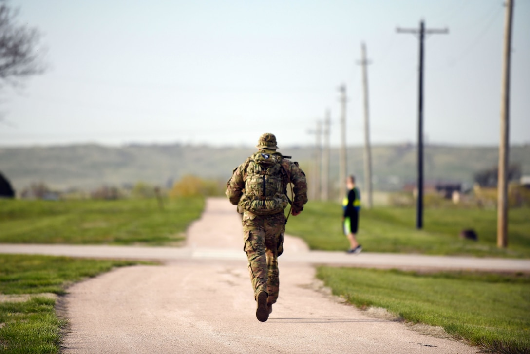 An Airman participates in the 4.5-mile Police Week Ruck Challenge at Heritage Lake on Ellsworth Air Force Base, S.D., May 13, 2019. The event was organized by the 28th Security Forces Squadron in honor of National Police Week. The week is dedicated to the countless numbers of law enforcement officers who have died while serving and protecting communities nationwide. (U.S. Air Force photo by Airman 1st Class Christina Bennett)