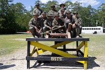 U.S. Marines and Sailors with 2nd Transportation Support Battalion, 2nd Marine Logistics Group (MLG), pose with a photo with their 1st place trophy after an awards ceremony at Camp Lejeune, North Carolina, May 15, 2019. Brig. Gen. Kevin J. Stewart, commanding officer of 2nd MLG, presented awards to the first, second, and third place winners of 2nd MLG's annual squad competition.