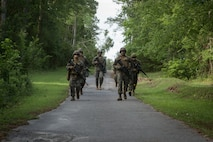 U.S. Marines and Sailors with Combat Logistics Regiment 2, 2nd Marine Logistics Group (MLG), patrol in formation during a squad competition at Camp Lejeune, North Carolina, May 14, 2019. The Marines and Sailors participated in 2nd MLG's annual squad competition to test their combat skills and to maintain operational readiness.