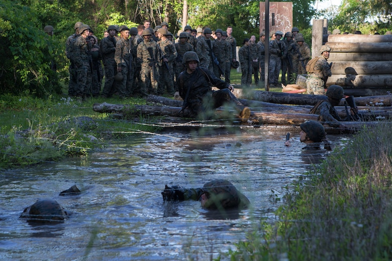 U.S. Marines and Sailors with Combat Logistics Regiment 2, 2nd Marine Logistics Group (2nd MLG) run through an endurance course during an annual squad competition at Camp Lejeune, North Carolina, May 15, 2019. The Marines and Sailors participated in the 2nd MLG annual squad competition to test their combat skills and to maintain operational readiness.