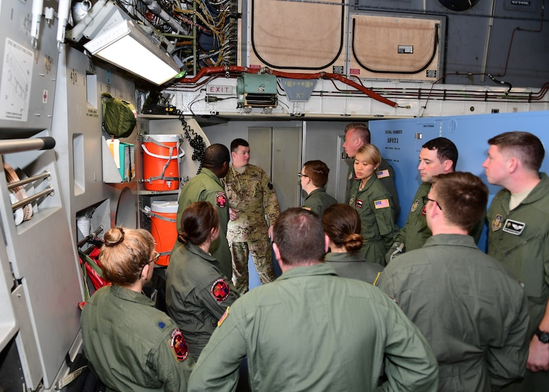 Staff Sgt. Carl Kocon, loadmaster with the 758th Airlift Squadron, teaches Airmen from the 914th Aeromedical Evacuation Squadron proper evacuation procedures at Barbers Point Airfield, Hawaii April 24, 2019. This was part of dissimilar aircraft training for the 914th AES Airmen as they usually work with KC-135 Stratotankers. (U.S. Air Force photo by Senior Airman Grace Thomson)