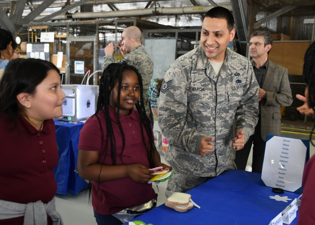 Participants in the Legends in Flight Joint Base Andrews  Air and Space Expo 2019 look at various set-ups in the Science Technology Engineering and Math hangar on JB Andrews, Md.,  May 10, 2019. More than 7,000 local students came out to the STEM hangars. (U.S. Air Force photo by Staff Sgt. Cierra Presentado)