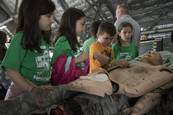 Participants in the Legends in Flight Joint Base Andrews  Air and Space Expo 2019 look at various set-ups in the Science Technology Engineering and Math hangar on JB Andrews, Md., May 10, 2019. More than 7,000 local students came out to participate in various activities in the STEM hangars. (U.S Air Force photo by Senior Airman Andreaa Phillips)