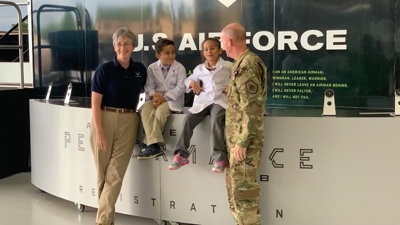 JoJo the Scientist and his sister, Grace, chat with Secretary of the Air Force Heather Wilson (left), and Air Force Vice Chief of Staff Stephen W. Wilson (right) at the Legends in Flight Joint Base Andrews Air & Space Expo 2019, at JB Andrews, Md., May 10, 2019. JoJo and approximately 7,000 other students were immersed in hands-on science, technology, engineering and mathematics activities among some 30 exhibits.