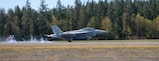 An EA-18G Growler assigned to VAQ 131 lands during a FCLP at an outlying landing field attached to Naval Air Station Whidbey Island.