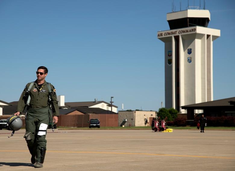 "U.S. Air Force Maj. Garret ""Toro"" Schmitz, F-16 Viper Demonstration Team commander and pilot, walks to his F-16CM Viper on the flight line at Joint Base Langley-Eustis, Va., May 15, 2019."