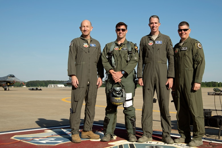 (From left) U.S. Air Force Gen. Mike Holmes, commander of Air Combat Command, Maj. Garret Schmitz, F-16 Viper Demonstration Team commander and pilot, Col. Derek O'Malley, 20th Fighter Wing commander, and Col. Brian Jackson, 20th Operations Group commander, stand for a photo at Joint Base Langley-Eustis, Va., May 16, 2019.