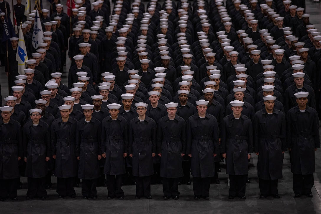 Sailors stand in formation.