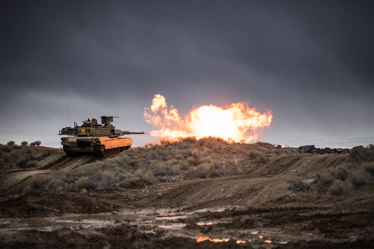 A tank fires its gun.