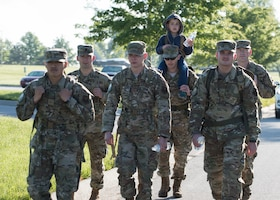 Capt. Daniel Merkh, the director of operations with the 509th Security Forces Squadron, carries his son Ben during a ruck march alongside other defenders with the 509th SFS on May 13, 2019, at Whiteman Air Force Base, Missouri.