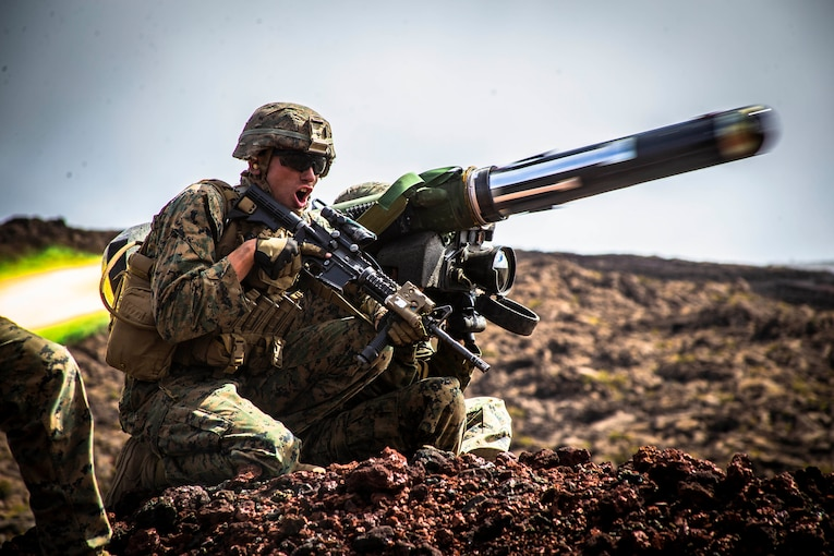 A Marine fires a Javelin from his shoulder