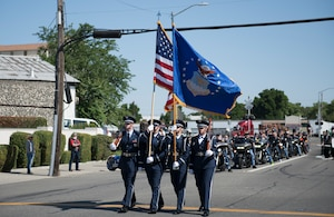 U.S. Air Force Airmen, assigned to the Travis Air Force Base Honor Guard, step off in formation as part of the annual Dixon May Fair Parade in Dixon, California, May 11, 2019. The Honor Guardsmen, along with Airmen from the 60th Operations Group and 60th Air Mobility Wing marched in the parade to promote community engagement and build strong partnerships. (U.S. Air Force photo by Airman 1st Class Amy Younger)