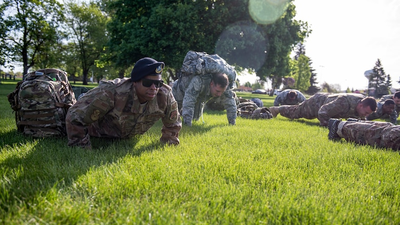 U.S. Air Force Staff Sgt. Kenny Gainey, 141st Security Forces readiness trainer, executes push-ups in honor of each defender who has lost their life in the line of duty since 9/11, during National Police Week at Fairchild Air Force Base, Washington, May 13, 2019. The 92nd SFS hosted numerous events for Team Fairchild to enjoy, including a Ruck and Run, a Memorial Retreat Ceremony and a kid-friendly Law Enforcement Exposition. (U.S. Air Force photo by Airman 1st Class Whitney Laine)