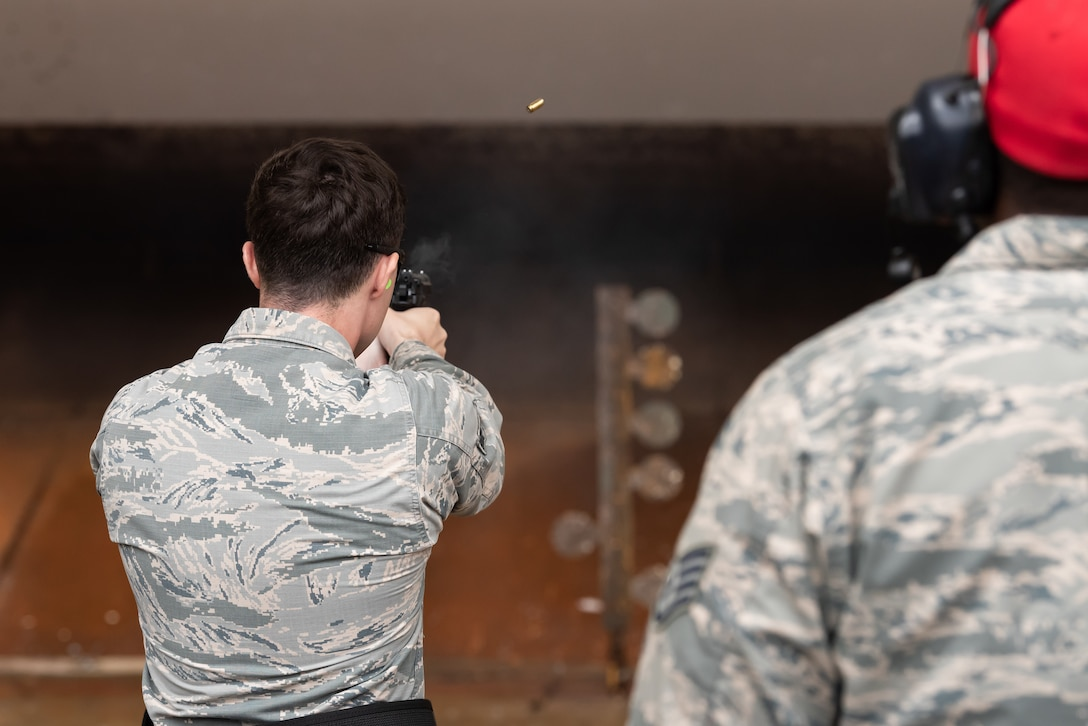 A U.S. Air Force Airman assigned to the 18th Security Forces Squadron, fires an M9 pistol during a stress fire competition May 17, 2019, at Kadena Air Base, Japan.