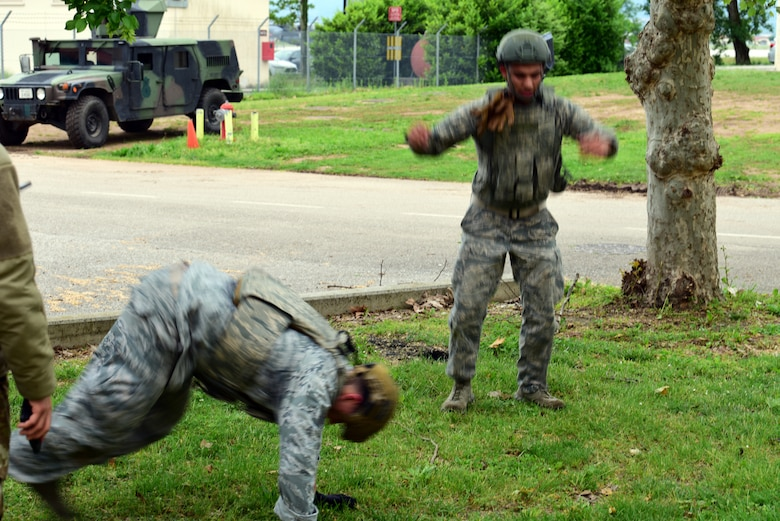 Participants were required to do burpees for each answer they got wrong during a quiz while taking part in the Police Week Combat Challenge that pit security forces Airmen against Joint International Non Commissioned Officers Development Course on May 15, 2019 at Aviano Air Base, Italy. A burpee is a four-count full body exercise. (U.S. Air Force photo by Airman 1st Class Caleb House)