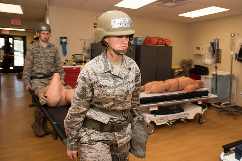 Senior Airman Erin Engle, front, and Airmen Benjamin Turner, both assigned to the 167th Medical Group, carry a litter with a simulated patient into an exam room at Alpena Combat Readiness Training Center, Alpena, Mich., May 7, 2019. Approximately 300 167th Airlift Wing Airmen participated in the training event. (U.S. Air National Guard photo by Tech. Sgt. Jodie Witmer)