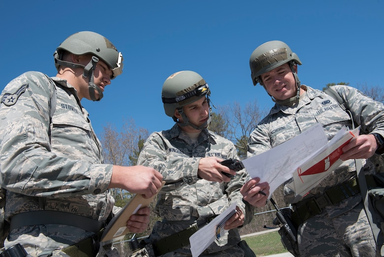 Senior Airman Andrew Stover, Staff Sgt. Phillip Wingerd and Senior Airman Zachary Langhorne, all assigned to the fuels section of the 167th Airlift Wing, review post attack procedures during a training exercise at Alpena Combat Readiness Training Center, Alpena, Mich., May 7, 2019. Approximately 300 167th AW Airmen participated in the training event. (U.S. Air National Guard photo by Senior Master Sgt. Emily Beightol-Deyerle)